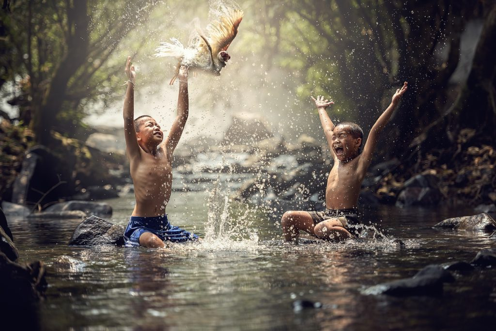 carefree children playing with water