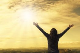 Girl standing with open arms, freedom, happiness